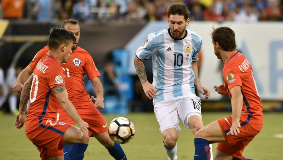 Argentina's Lionel Messi (2-R) drives the ball marked by Chile's Charles Aranguiz (L) during the Copa America Centenario final in East Rutherford, New Jersey, United States, on June 26, 2016.  / AFP / NELSON ALMEIDA        (Photo credit should read NELSON ALMEIDA/AFP/Getty Images)