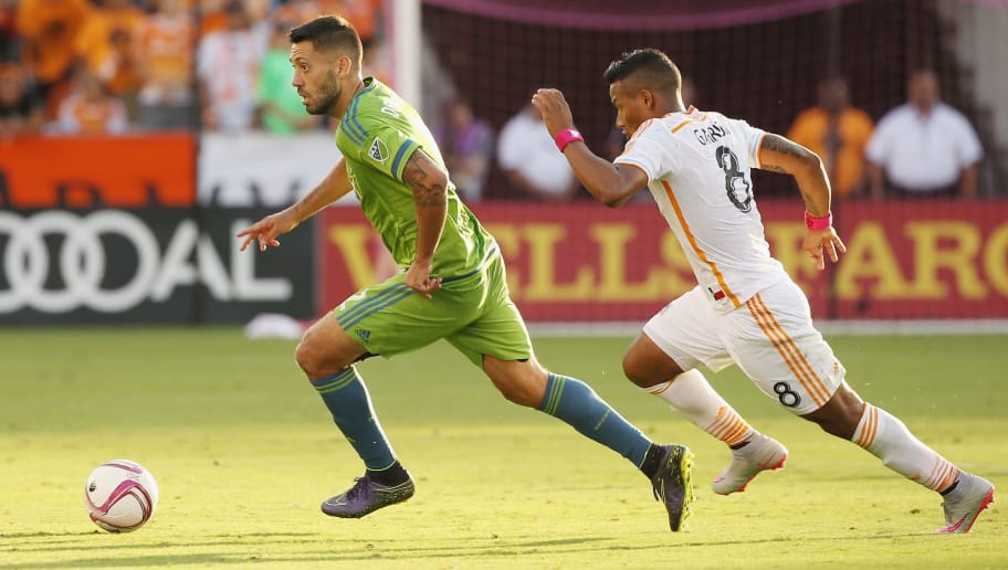 HOUSTON, TX - OCTOBER 18:  Clint Dempsey #2 of the Seattle Sounders FC and Luis Garrido #8 of the Houston Dynamo battle for the ball in the second half of their game at BBVA Compass Stadium on October 18, 2015 in Houston, Texas.  (Photo by Scott Halleran/Getty Images)