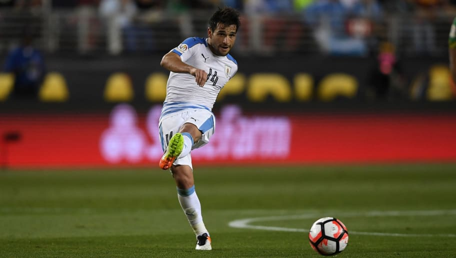 SANTA CLARA, CA - JUNE 13:  Nicolas Lodeiro #14 of Uruguay passes the ball up field against Jamaica during the 2016 Copa America Centenario Group match play between Uruguay and Jamaica at Levi's Stadium on June 13, 2016 in Santa Clara, California.  (Photo by Thearon W. Henderson/Getty Images)