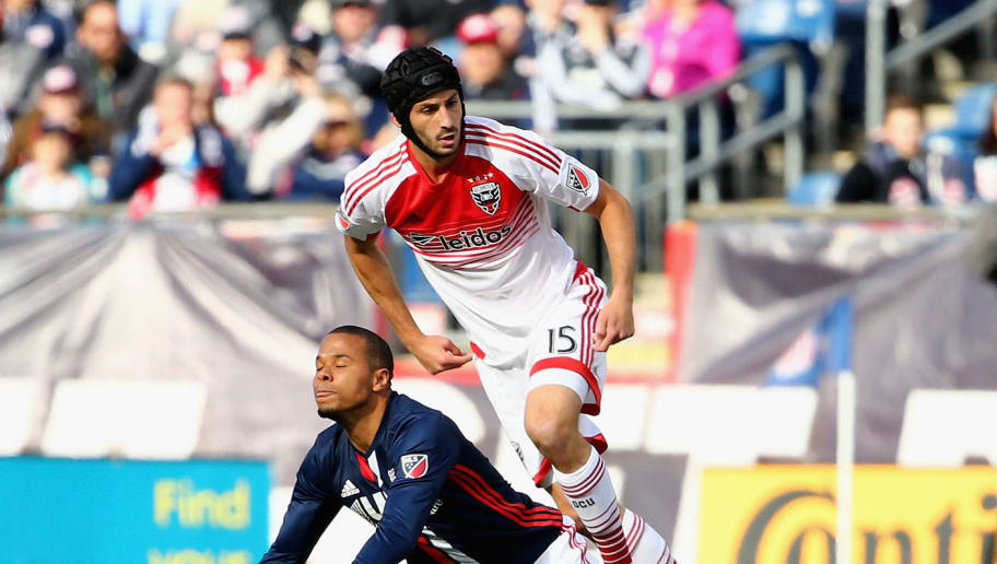 FOXBORO, MA - MARCH 12:  Charlie Davies #9 of New England Revolution gets tripped up with Steve Birnbaum #15 of D.C. United during the first half at Gillette Stadium on March 12, 2016 in Foxboro, Massachusetts.  (Photo by Maddie Meyer/Getty Images)