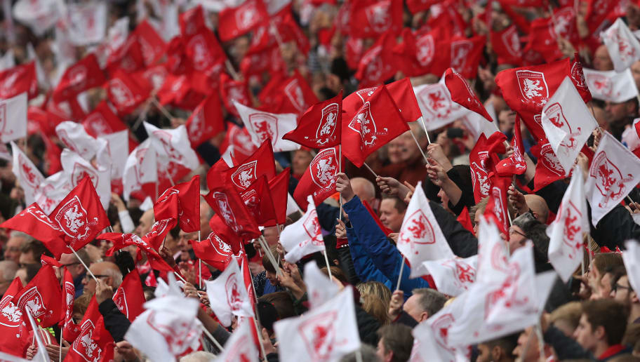 MIDDLESBROUGH, ENGLAND - MAY 07: Middlesbrough fans wave flags during the Sky Bet Championship match between Middlesbrough and Brighton and Hove Albion at the Riverside Stadium on May 7, 2016 in Middlesbrough, England. (Photo by Chris Brunskill/Getty Images)