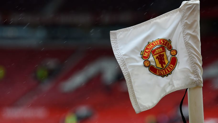 The Manchester United badge is seen on a corner flag ahead of the English Premier League football match between Manchester United and Manchester City at Old Trafford in Manchester, north west England on April 12, 2015. AFP PHOTO / PAUL ELLIS   RESTRICTED TO EDITORIAL USE. No use with unauthorized audio, video, data, fixture lists, club/league logos or live services. Online in-match use limited to 45 images, no video emulation. No use in betting, games or single club/league/player publications.        (Photo credit should read PAUL ELLIS/AFP/Getty Images)