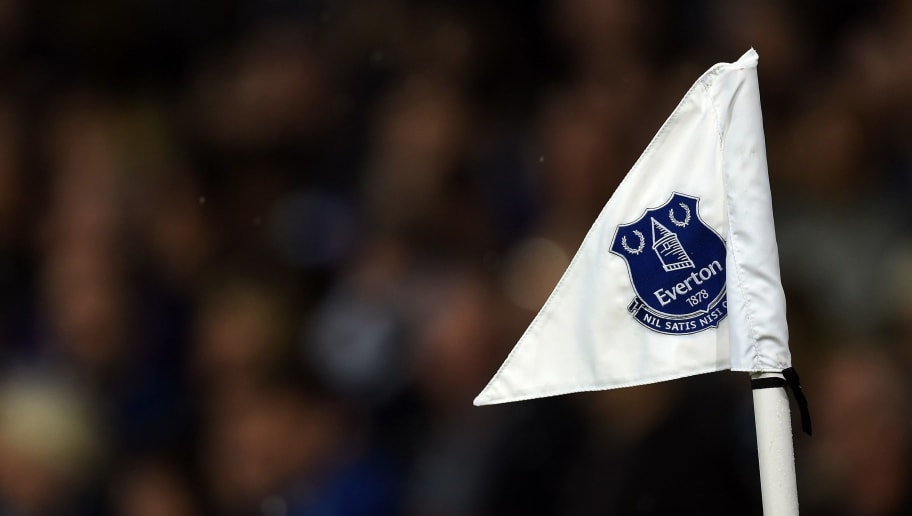 Everton's club crest is seen on the corner flag during the English Premier League football match between Everton and Leicester City at Goodison Park in Liverpool, north west England on December 19, 2015. AFP PHOTO / PAUL ELLIS  RESTRICTED TO EDITORIAL USE. NO USE WITH UNAUTHORIZED AUDIO, VIDEO, DATA, FIXTURE LISTS, CLUB/LEAGUE LOGOS OR 'LIVE' SERVICES. ONLINE IN-MATCH USE LIMITED TO 75 IMAGES, NO VIDEO EMULATION. NO USE IN BETTING, GAMES OR SINGLE CLUB/LEAGUE/PLAYER PUBLICATIONS. / AFP / PAUL ELLIS        (Photo credit should read PAUL ELLIS/AFP/Getty Images)