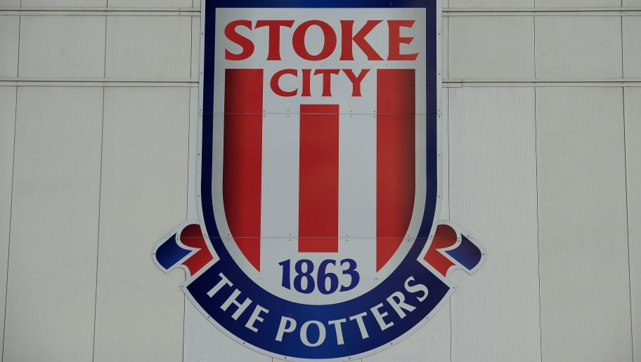 STOKE ON TRENT, ENGLAND - NOVEMBER 22: The Stoke City FC club badge ahead of the Barclays Premier League match between Stoke City and Burnley at Britannia Stadium on November 22, 2014 in Stoke on Trent, England.  (Photo by Tony Marshall/Getty Images)