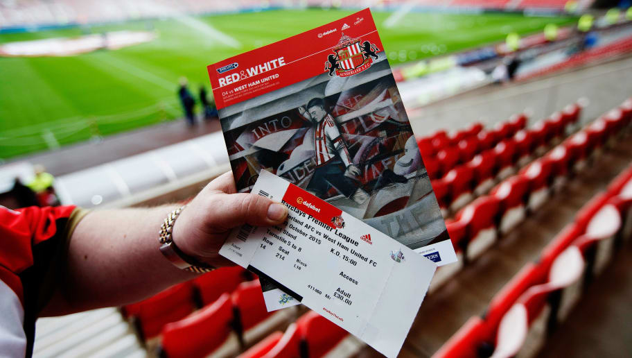 SUNDERLAND, ENGLAND - OCTOBER 03:  A Sunderland fan holds a matchday programme and a ticket prior to the Barclays Premier League match between Sunderland and West Ham United at the Stadium of Light in Sunderland, United Kingdom.  (Photo by Steve Welsh/Getty Images)