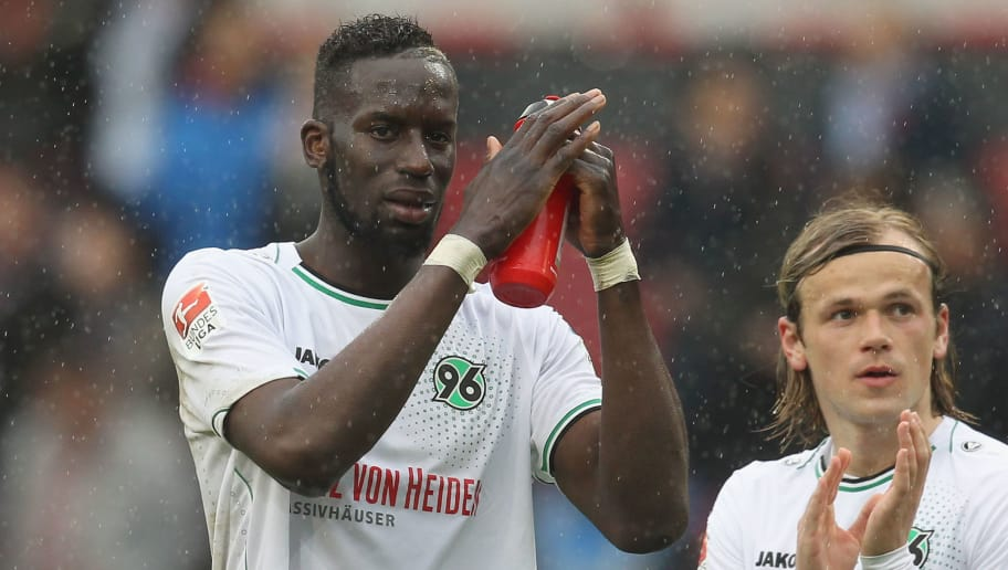 INGOLSTADT, GERMANY - APRIL 23:  Iver Fossum (R) and Salif Sane of Hannover 96 react to their fans after the Bundesliga match between FC Ingolstadt and Hannover 96 at Audi Sportpark on April 23, 2016 in Ingolstadt, Germany.  (Photo by Alexandra Beier/Bongarts/Getty Images)