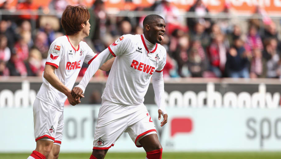 COLOGNE, GERMANY - APRIL 23: Anthony Modeste of Cologne (R) is helped up by Yuya Osako during the Bundesliga match between 1. FC Koeln and SV Darmstadt 98 at RheinEnergieStadion on April 23, 2016 in Cologne, Germany.  (Photo by Juergen Schwarz/Bongarts/Getty Images)