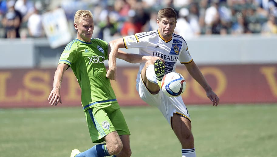 CARSON CA - AUGUST 9: Steven Gerrard #8 of the Los Angeles Galaxy controls the ball against Andy Rose #5 of the Seattle Sounders during the second half of the MLS soccer match at StubHub Center August 9, 2015, in Carson, California. (Photo by Kevork Djansezian/Getty Images)