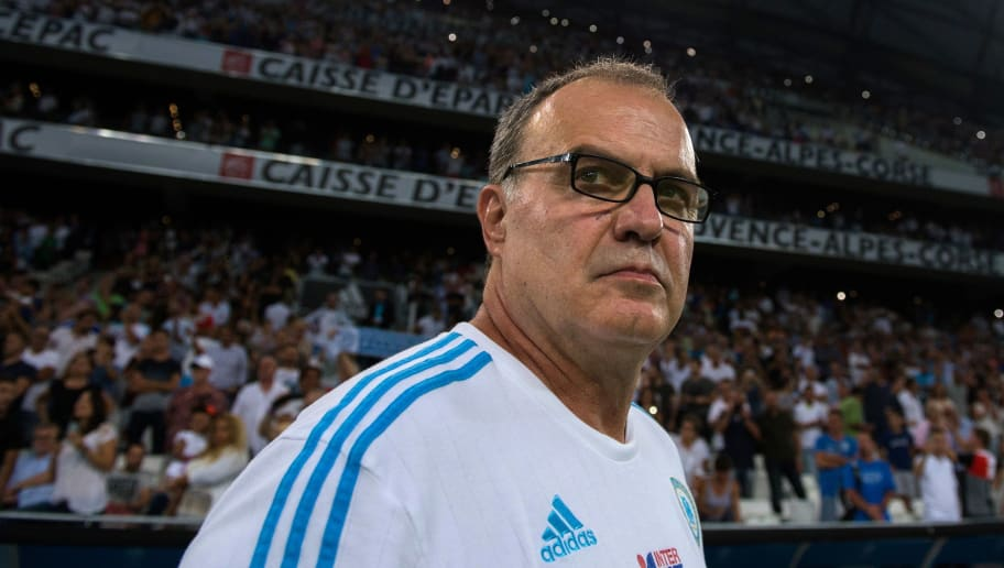 Marseille's Argentinian head coach Marcelo Bielsa looks on prior to the French L1 football match between Olympique de Marseille and Stade Malherbe de Caen on August 8, 2015 at the Velodrome stadium in Marseille, southern France. Marcelo Bielsa stunned French football on August 8 when he quit as coach of Marseille just minutes after his team had lost their season opener 1-0 at Caen. 'I have resigned from my post as manager of Marseille,' the Argentine announced at the end of his post-match news conference. AFP PHOTO / BERTRAND LANGLOIS        (Photo credit should read BERTRAND LANGLOIS/AFP/Getty Images)