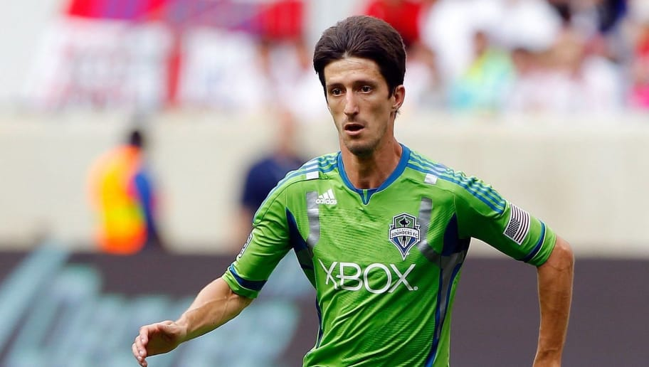 HARRISON, NJ - JULY 15:  Alvaro Fernandez #15 of the Seattle Sounders in action against the New York Red Bulls at Red Bull Arena on July 15, 2012 in Harrison, New Jersey.  (Photo by Jim McIsaac/Getty Images)