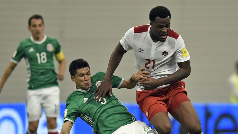 Mexico's Jesus Molina(L) and Canada's Cyle Larin vie for the ball during their Russia 2018 FIFA World Cup Concacaf Qualifiers' football match, in Mexico City, on March 29, 2016. AFP PHOTO / ALFREDO ESTRELLA / AFP / ALFREDO ESTRELLA        (Photo credit should read ALFREDO ESTRELLA/AFP/Getty Images)