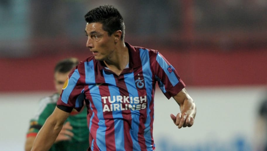 TRABZON,TURKEY - OCTOBER 2: Oscar Cardozo of Trabzonspor AS in action during the UEFA Europa League Group L match between Trabzonspor AS and Legia Warszawa at the Hüseyin Avni Aker Stadium on October 2, 2014 in Trabzon,Turkey. (Photo by EuroFootball/Getty Images)