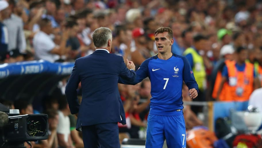 MARSEILLE, FRANCE - JULY 07:  Didier Deschamps (L) manager of France congratulates Antoine Griezmann (R) after substituting himduring the UEFA EURO semi final match between Germany and France at Stade Velodrome on July 7, 2016 in Marseille, France.  (Photo by Alex Livesey/Getty Images)
