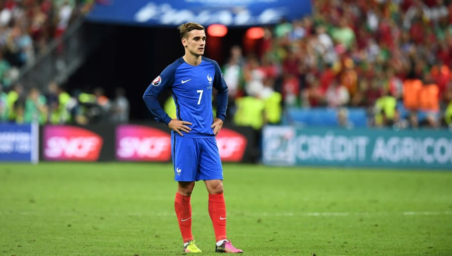 TOPSHOT - France's forward Antoine Griezmann reacts after Portugal beat their hosts France 1-0 in the Euro 2016 final football match between France and Portugal at the Stade de France in Saint-Denis, north of Paris, on July 10, 2016. / AFP / FRANCK FIFE        (Photo credit should read FRANCK FIFE/AFP/Getty Images)