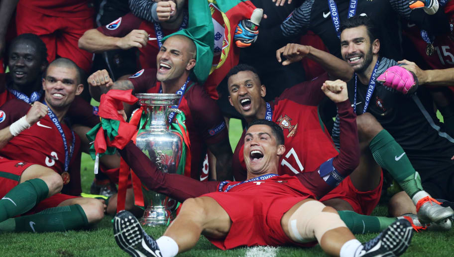 (From L) Portugal's forward Eder, Portugal's defender Pepe, Portugal's forward Ricardo Quaresma Portugal's forward Nani, Portugal's forward Cristiano Ronaldo and Portugal's goalkeeper Rui Patricio pose with the trophy as they celebrate after beating France during the Euro 2016 final football match at the Stade de France in Saint-Denis, north of Paris, on July 10, 2016. / AFP / Valery HACHE        (Photo credit should read VALERY HACHE/AFP/Getty Images)