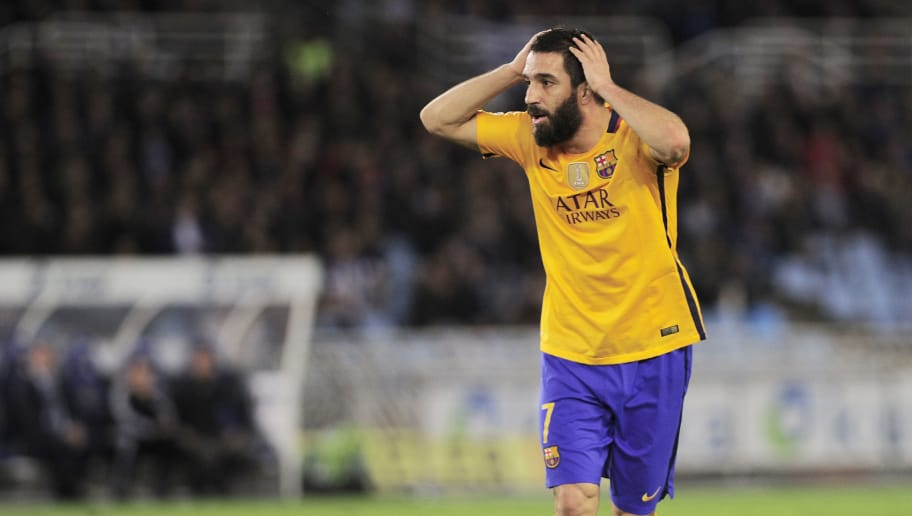 Barcelona's Turkish midfielder Arda Turan gestures during the Spanish league football match Real Sociedad vs FC Barcelona at the Anoeta stadium in San Sebastian on April 9, 2016. / AFP / ANDER GILLENEA        (Photo credit should read ANDER GILLENEA/AFP/Getty Images)