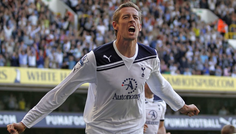 Tottenham Hotspur's English striker Peter Crouch celebrates scoring the opening goal of the English Premier League football match between Tottenham Hotspur and Stoke City at White Hart Lane in north London, England on April 9, 2011. AFP PHOTO/IAN KINGTONFOR EDITORIAL USE ONLY Additional licence required for any commercial/promotional use or use on TV or internet (except identical online version of newspaper) of Premier League/Football League photos. Tel DataCo +44 207 2981656. Do not alter/modify photo. (Photo credit should read IAN KINGTON/AFP/Getty Images)