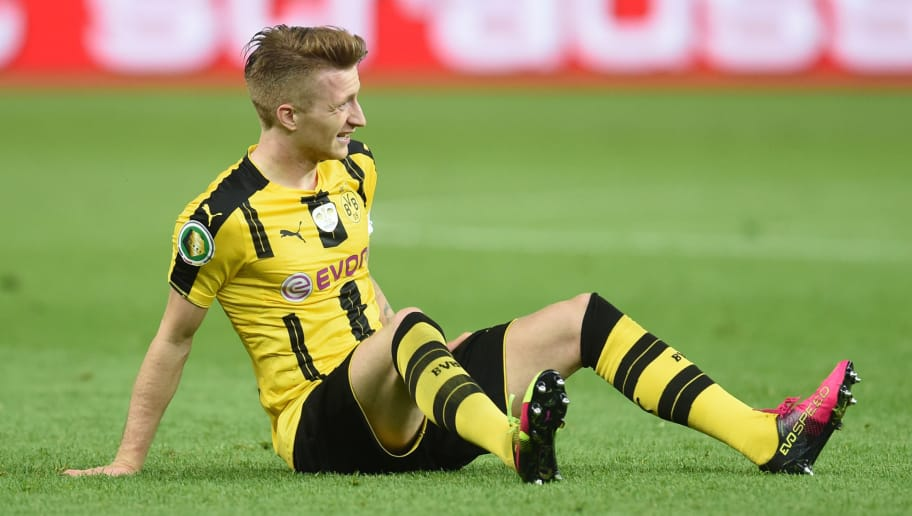 Dortmund's midfielder Marca Reus sits at the field during the German Cup (DFB Pokal) final football match Bayern Munich vs Borussia Dortmund at the Olympic stadium in Berlin on May 21, 2016. / AFP / CHRISTOF STACHE / RESTRICTIONS: ACCORDING TO DFB RULES IMAGE SEQUENCES TO SIMULATE VIDEO IS NOT ALLOWED DURING MATCH TIME. MOBILE (MMS) USE IS NOT ALLOWED DURING AND FOR FURTHER TWO HOURS AFTER THE MATCH. == RESTRICTED TO EDITORIAL USE == FOR MORE INFORMATION CONTACT DFB DIRECTLY AT +49 69 67880   /         (Photo credit should read CHRISTOF STACHE/AFP/Getty Images)
