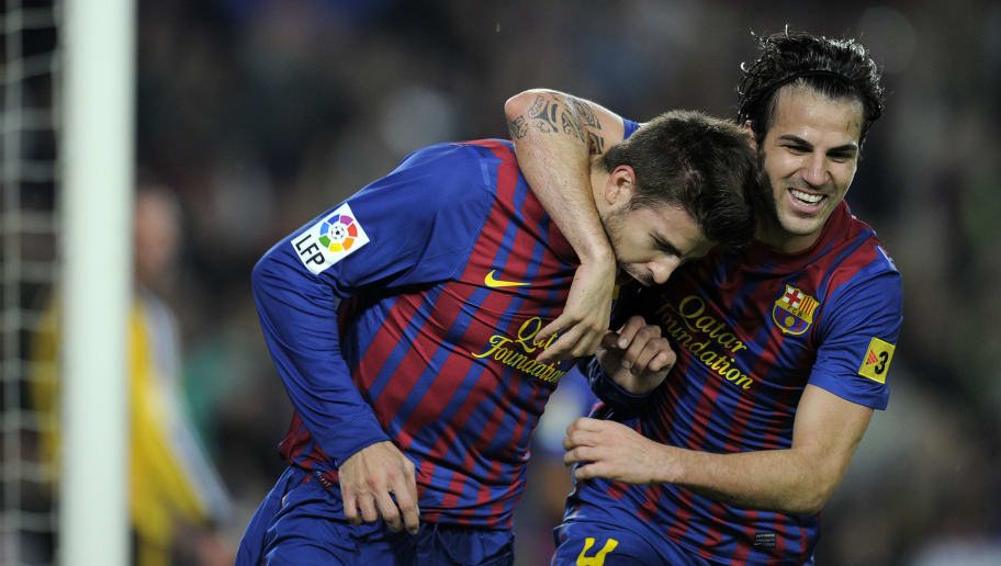Barcelona's defender Gerard Pique (L) and Barcelona's forward Cesc Fabregas (R) celebrate after scoring against Real Zaragoza during their Spanish League football match at Camp Nou stadium in Barcelona on November 19, 2011. AFP PHOTO/LLUIS GENE (Photo credit should read LLUIS GENE/AFP/Getty Images)