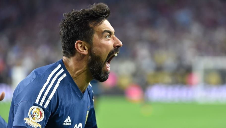Argentina's Ezequiel Lavezzi celebrates after scoring against USA during their Copa America Centenario semifinal football match in Houston, Texas, United States, on June 21, 2016.  / AFP / Omar Torres        (Photo credit should read OMAR TORRES/AFP/Getty Images)