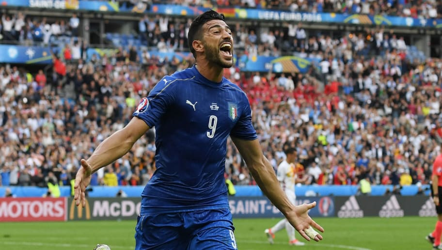 PARIS, FRANCE - JUNE 27:  Graziano Pelle of Italy celebrates scoring his team's second goal during the UEFA EURO 2016 round of 16 match between Italy and Spain at Stade de France on June 27, 2016 in Paris, France.  (Photo by Matthias Hangst/Getty Images)