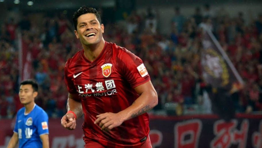 This picture taken on July 10, 2016 shows Hulk (C) of Shanghai SIPG celebrating after scoring a goal during the 16th round football match of the Chinese Super League against Henan Jianye in Shanghai.  Record Asian signing Hulk scored on his Chinese Super League debut but was carried off injured minutes later as Shanghai SIPG smashed Henan Jianye 5-0 at the weekend. / AFP / STR / China OUT        (Photo credit should read STR/AFP/Getty Images)