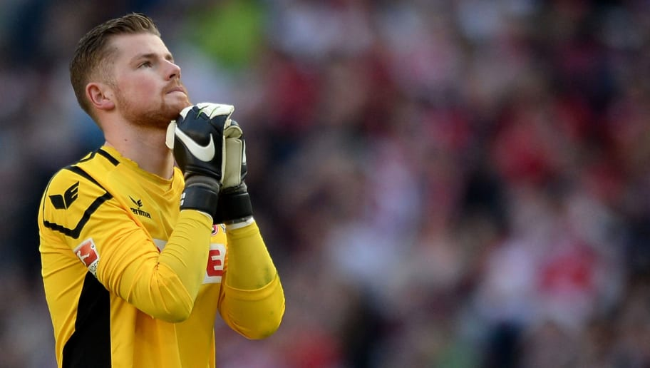 COLOGNE, NORTH RHINE-WESTPHALIA - APRIL 10:  Goalkeeper Timo Horn reacts during the Bundesliga match between 1. FC Koeln and Bayer Leverkusen at RheinEnergieStadion on April 10, 2016 in Cologne, Germany.  (Photo by Sascha Steinbach/Bongarts/Getty Images)