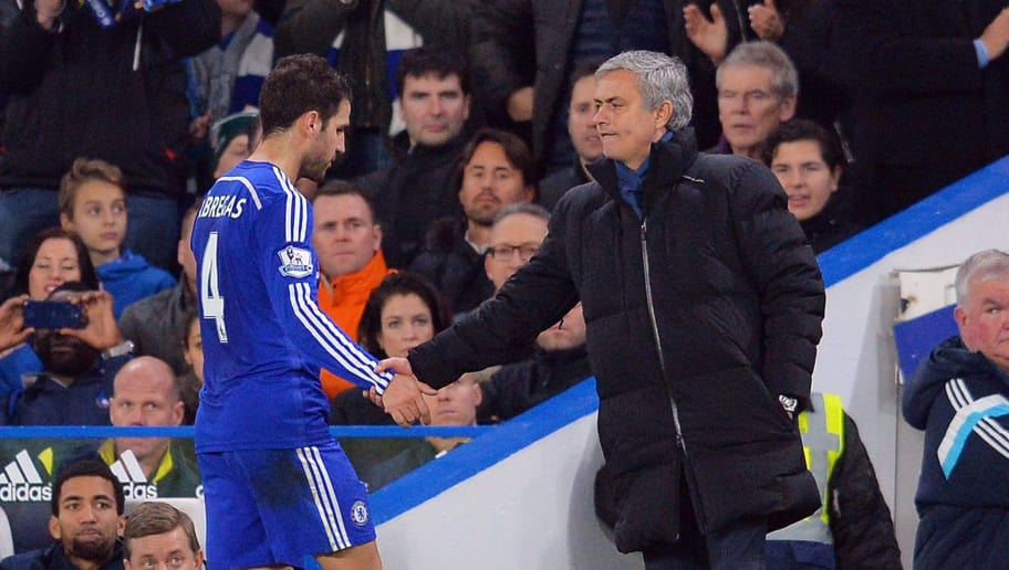 Chelsea's Portuguese manager Jose Mourinho (R) shakes hands with Spanish midfielder Cesc Fabregas (L) after he is substituted during the English Premier League football match between Chelsea and Tottenham Hotspur at Stamford Bridge in London on December 3, 2014. Chelsea won the game 3-0. AFP PHOTO/GLYN KIRK  RESTRICTED TO EDITORIAL USE. NO USE WITH UNAUTHORIZED AUDIO, VIDEO, DATA, FIXTURE LISTS, CLUB/LEAGUE LOGOS OR 'LIVE' SERVICES. ONLINE IN-MATCH USE LIMITED TO 45 IMAGES, NO VIDEO EMULATION. NO USE IN BETTING, GAMES OR SINGLE CLUB/LEAGUE/PLAYER PUBLICATIONS.        (Photo credit should read GLYN KIRK/AFP/Getty Images)