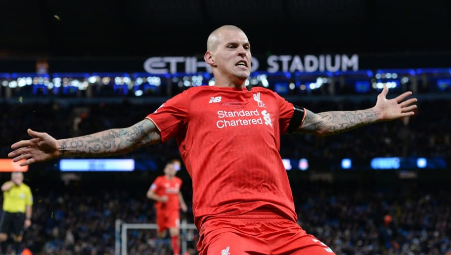 Liverpool's Slovakian defender Martin Skrtel celebrates after scoring their fourth goal of the English Premier League football match between Manchester City and Liverpool at The Etihad stadium in Manchester, north west England on November 21, 2015. AFP PHOTO / OLI SCARFF  RESTRICTED TO EDITORIAL USE. No use with unauthorized audio, video, data, fixture lists, club/league logos or 'live' services. Online in-match use limited to 75 images, no video emulation. No use in betting, games or single club/league/player publications.        (Photo credit should read OLI SCARFF/AFP/Getty Images)