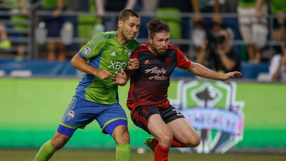 SEATTLE, WA - JULY 13:  Clint Dempsey #2 (L) of the Seattle Sounders battles Danny O'Rourke #25 of the Portland Timbers at CenturyLink Field on July 13, 2014 in Seattle, Washington.  (Photo by Otto Greule Jr/Getty Images)
