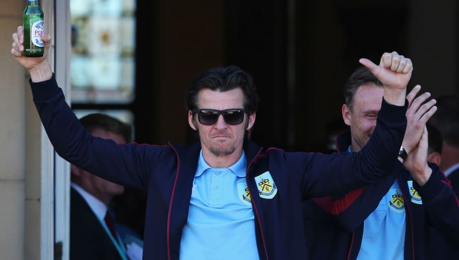 BURNLEY, ENGLAND - MAY 09:  Joey Barton salutes the crowd as Sky Bet Champions Burnley are presented with the Championship trophy at the Town Hall on May 9, 2016 in Burnley, England.  (Photo by Jan Kruger/Getty Images)