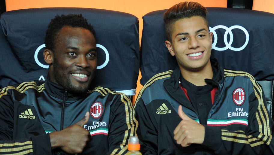 MILAN, ITALY - MAY 18:  Michael Essien (L) and Hachim Mastour of AC Milan prior to the Serie A match between AC Milan and US Sassuolo Calcio at San Siro Stadium on May 18, 2014 in Milan, Italy.  (Photo by Claudio Villa/Getty Images)