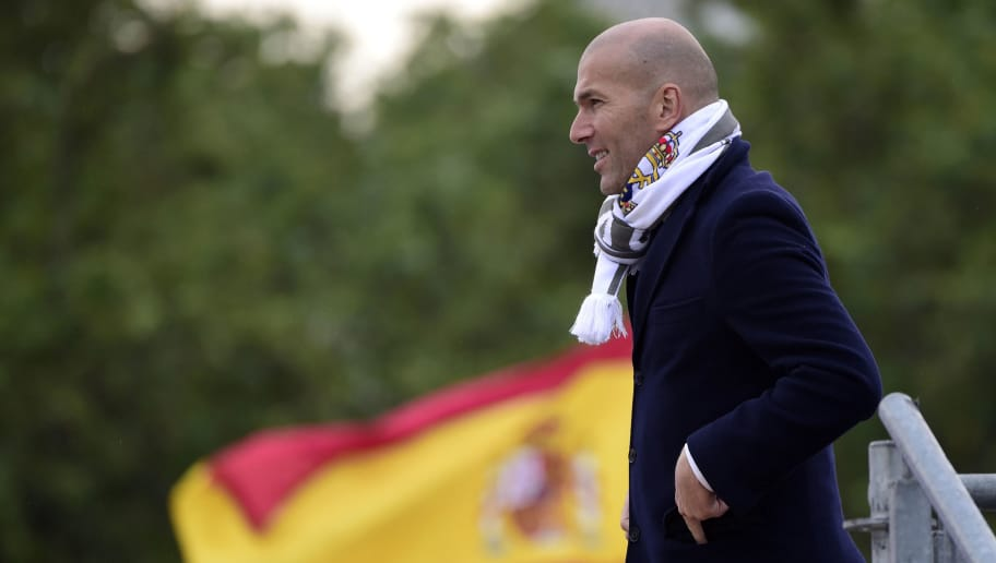 Real Madrid's French coach Zinedine Zidane celebrates the team's win on Plaza Cibeles in Madrid on May 29, 2016 after the UEFA Champions League final foobtall match between Real Madrid CF, Club Atletico de Madrid held in Milan, Italy. / AFP / JAVIER SORIANO        (Photo credit should read JAVIER SORIANO/AFP/Getty Images)