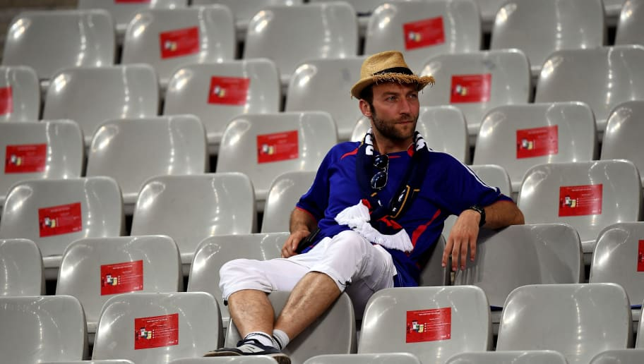 PARIS, FRANCE - JULY 10:  A dejected France supporter remains in the stand after the UEFA EURO 2016 Final match between Portugal and France at Stade de France on July 10, 2016 in Paris, France.  (Photo by Laurence Griffiths/Getty Images)
