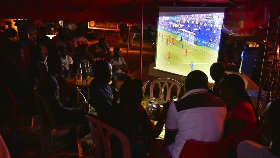 People view the Euro 2016 final between Portugal and France on television July 10, 2016 in Abidjan, Ivory Coast.  Portugal beat hosts France 1-0 in the Euro 2016 final thanks to substitute Eder's dramatic strike in extra-time at the Stade de France. / AFP / SIA-KAMBOU        (Photo credit should read SIA-KAMBOU/AFP/Getty Images)