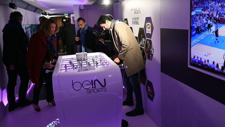 French journalist Alexandre Ruiz (R) plays with BeIn Sports journalist Anne-Laure Bonnet in the 'UEFA EURO 2016 Trophy tour' train stationed in Gare de Lyon in Paris on April 2, 2016 before touring France ahead of the Euro 2016 to be held from June 10 to July 10. The train is made up of four carriages proposing to visitors 30 different animations, and will travel through 25 cities in France, from 1 April to 9 June.  / AFP / FRANCK FIFE        (Photo credit should read FRANCK FIFE/AFP/Getty Images)