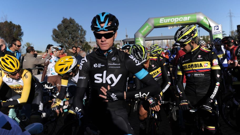 Team Sky's British cyclist Christopher Froome (C) waits for the start of the first half stage 118.3km route from Rabida to Hinojos near Huelva on February 14, 2015.  AFP PHOTO/ CRISTINA QUICLER        (Photo credit should read CRISTINA QUICLER/AFP/Getty Images)