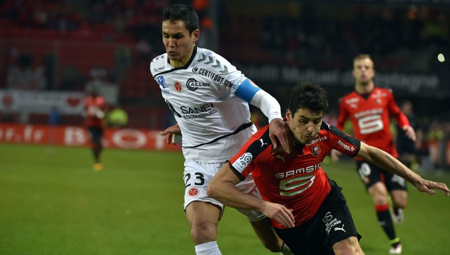 Reims' Algerian defender Aissa Mandi (L) vies with Rennes' French midfielder Yoann Gourcuff during the French L1 football match between Rennes and  Reims on April 2, 2016 at the Roazhon Park stadium in Rennes, western France. AFP PHOTO / LOIC VENANCE / AFP / LOIC VENANCE        (Photo credit should read LOIC VENANCE/AFP/Getty Images)