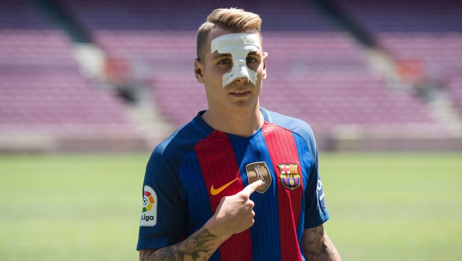 Barcelona's new player French defender Lucas Digne poses during his official presentation at the Camp Nou stadium in Barcelona, after signing his new contract with the Catalan club, on July 14, 2016.  / AFP / JOSEP LAGO        (Photo credit should read JOSEP LAGO/AFP/Getty Images)