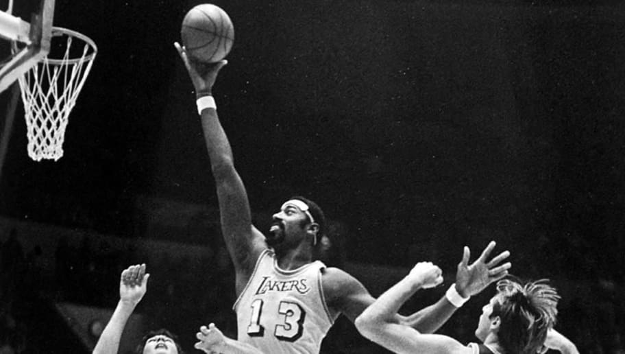 (FILES) In this 22 November 1970 file photo, Los Angeles Lakers basketball legend Wilt Chamberlain is shown shooting a layup during a game against Seattle.  Chamberlain was found dead at his Bel Air home 12 October 1999, apparently of natural causes. He was 63.     AFP PHOTO/FILES/Wen ROBERTS (Photo credit should read WEN ROBERTS/AFP/Getty Images)