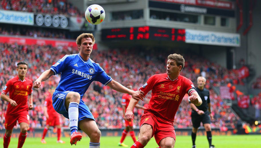 LIVERPOOL, ENGLAND - APRIL 27:  Tomas Kalas of Chelsea controls the ball under pressure from Steven Gerrard of Liverpool during the Barclays Premier League match between Liverpool and Chelsea at Anfield on April 27, 2014 in Liverpool, England.  (Photo by Clive Brunskill/Getty Images)
