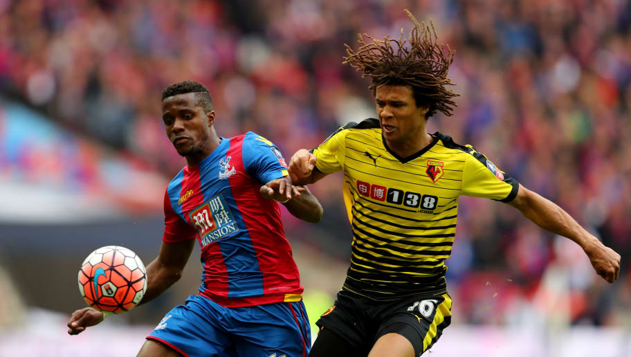 LONDON, ENGLAND - APRIL 24:  Nathan Ake of Watford and Wilfried Zaha of Crystal Palace battle for the ball during The Emirates FA Cup semi final match between Watford and Crystal Palace at Wembley Stadium on April 24, 2016 in London, England.  (Photo by Richard Heathcote/Getty Images)