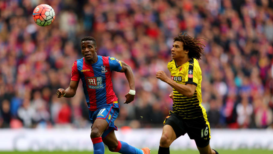 LONDON, ENGLAND - APRIL 24:  Nathan Ake of Watford and Wilfried Zaha of Crystal Palace chase the ball during The Emirates FA Cup semi final match between Watford and Crystal Palace at Wembley Stadium on April 24, 2016 in London, England.  (Photo by Richard Heathcote/Getty Images)