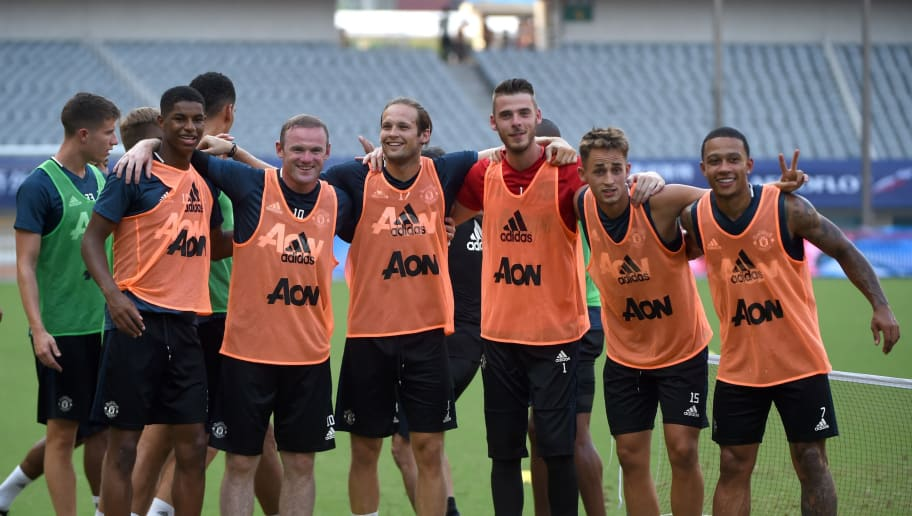 Manchester United's Wayne Rooney (front 2nd L) takes part in a training session with teammates ahead of the 2016 International Champions Cup football match between Manchester United and Dortmund in Shanghai on July 21, 2016. / AFP / WANG ZHAO        (Photo credit should read WANG ZHAO/AFP/Getty Images)