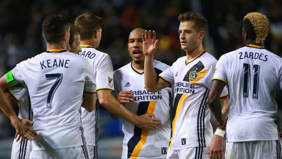CARSON, CA - MARCH 06: (L-R) Robbie Keane #7, Mike Magee #18, Steven Gerrard #8, Nigel de Jong #34, Robbie Rogers #14 andGyasi Zerdes #11 of Los Angeles Galaxy celebrate after Keane scored on a penalty kick in the second half of their MLS match against D.C. United at StubHub Center on March 6, 2016 in Carson, California. The Galaxy defeated United 4-1.  (Photo by Victor Decolongon/Getty Images)