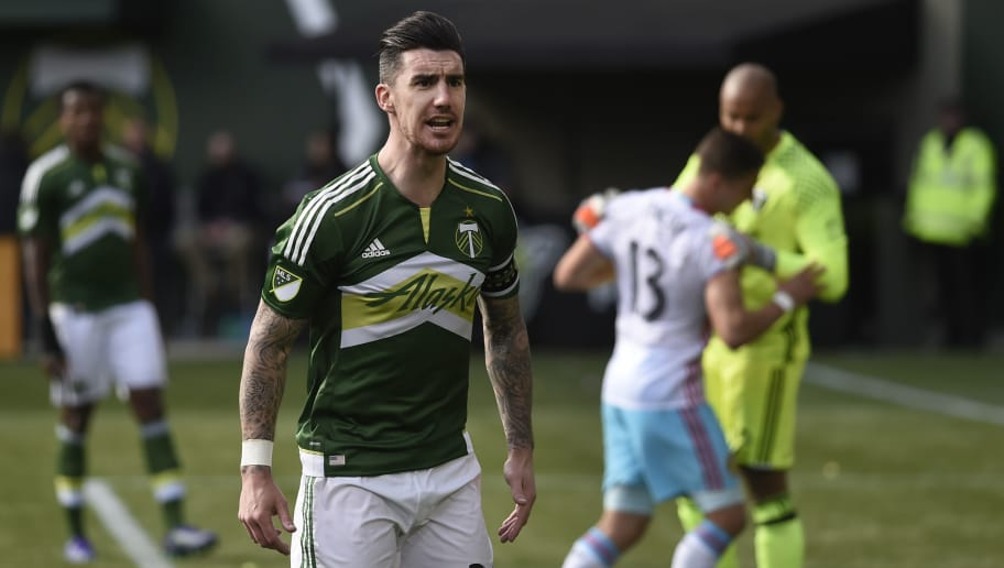 PORTLAND, OR - MARCH 6: Liam Ridgewell #24 of Portland Timbers has some words with the side judge during the second half of the game against the Columbus Crew at Providence Park on March 6, 2016 in Portland, Oregon. The Timbers won the match 2-1. (Photo by Steve Dykes/Getty Images)