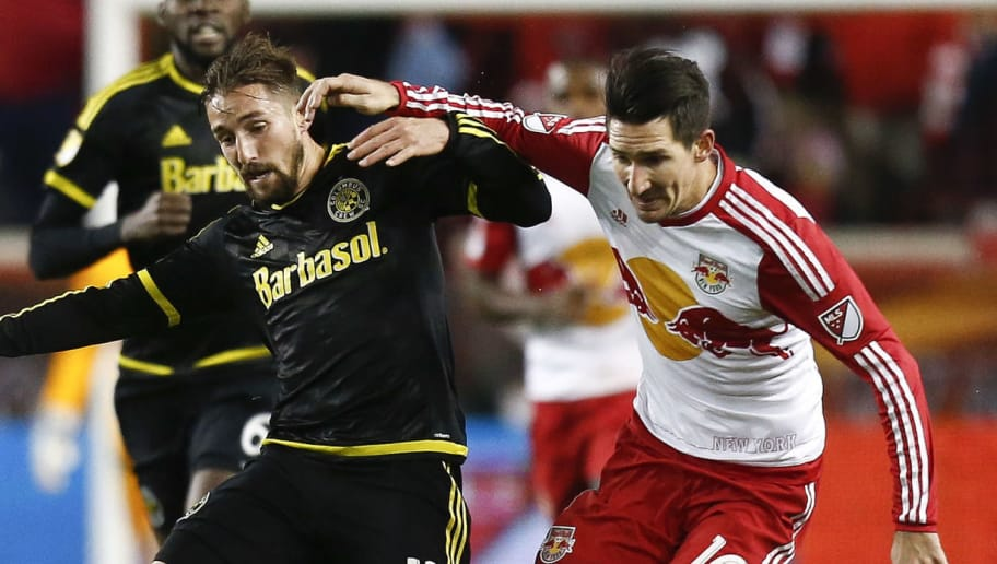 HARRISON, NJ - NOVEMBER 29:  Ethan Finlay #13 of Columbus Crew fights for the ball with Sacha Kljestan #16 of New York Red Bulls during their match at Red Bull Arena on November 29, 2015 in Harrison, New Jersey.  (Photo by Jeff Zelevansky/Getty Images)
