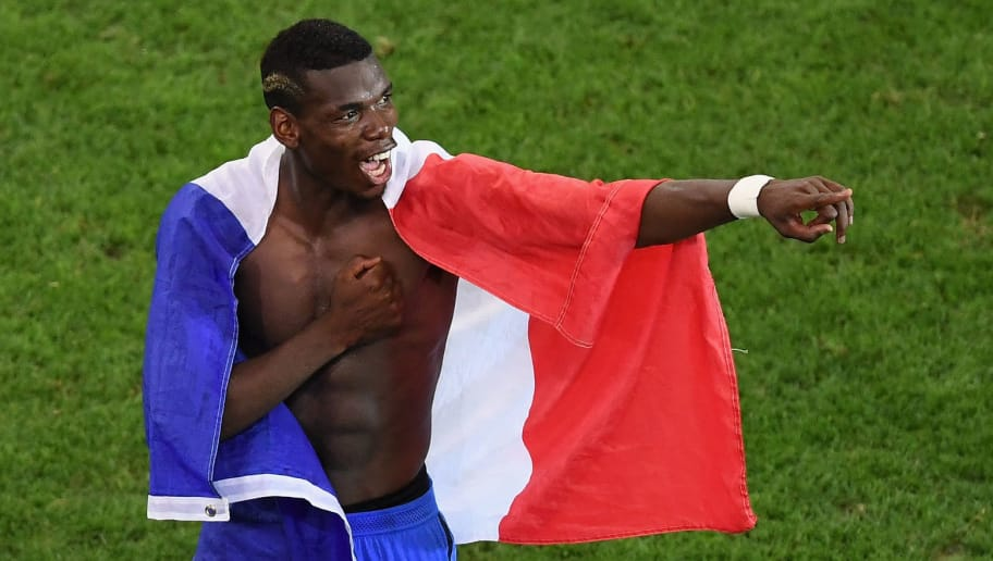 MARSEILLE, FRANCE - JULY 07:  Paul Pogba of France celebrates his team's 2-0 win in the UEFA EURO semi final match between Germany and France at Stade Velodrome on July 7, 2016 in Marseille, France.  (Photo by Laurence Griffiths/Getty Images)