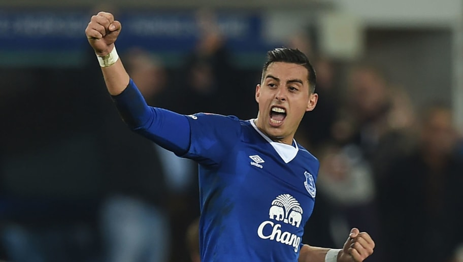 Everton's Argentinian defender Ramiro Funes Mori celebrates on the final whistle in the English FA cup quarter-final football match between Everton and Chelsea at Goodison Park in Liverpool, north west England on March 12, 2016. Everton won the game 2-0. / AFP / Paul ELLIS / RESTRICTED TO EDITORIAL USE. No use with unauthorized audio, video, data, fixture lists, club/league logos or 'live' services. Online in-match use limited to 75 images, no video emulation. No use in betting, games or single club/league/player publications.  /         (Photo credit should read PAUL ELLIS/AFP/Getty Images)