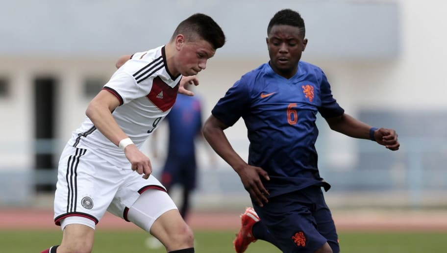 VILA REAL DE SANTO ANTONIO, PORTUGAL - FEBRUARY 16: Renat Dadachov of Germany challenges Leandro Fernandes of Netherlands during the U16 UEFA development tournament between Germany and Netherlands on February 16, 2015 in Vila Real de Santo Antonio, Portugal.  (Photo by Filipe Farinha/Bongarts/Getty Images)